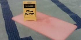 Precaución, zona mojada