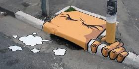 Arte callejero: alcantarilla fumadora